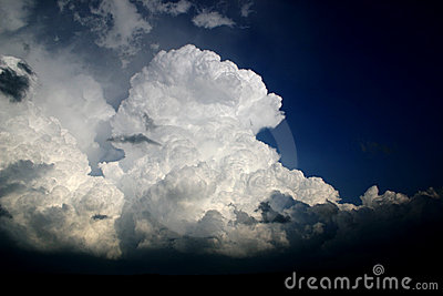 Towering cumulus thunderstorm clouds