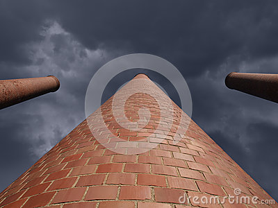 Towering Smokestacks with Storm Sky