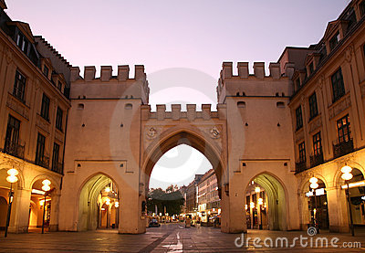 Towers with arches in street  European city in eve