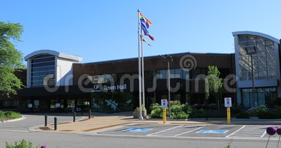 Town Hall in Oakville, Canada with flags in front 4K. The Town Hall in Oakville, Canada with flags in front 4K stock footage