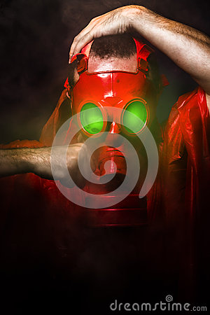 Toxic horror concept, man with red gas mask.