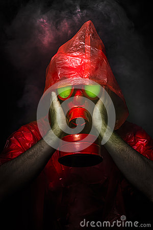 Toxic military concept, man with red gas mask.