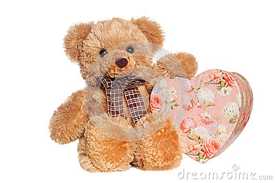 Toy bear holding heart-shaped present box