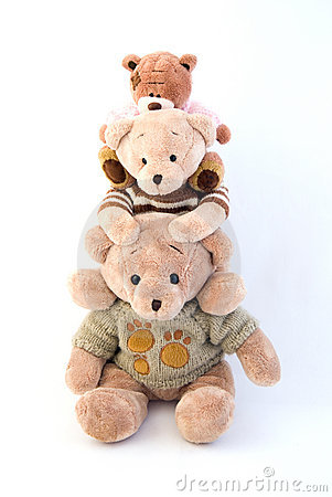 Toy bears sitting on the shoulders of each other