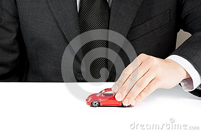 Toy car and hand of business man, concept for insurance, buying, renting, fuel or service and repair costs