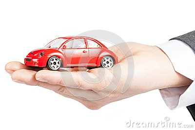 Toy car in the hand of business man concept for insurance, buying, renting, fuel or service and repair costs