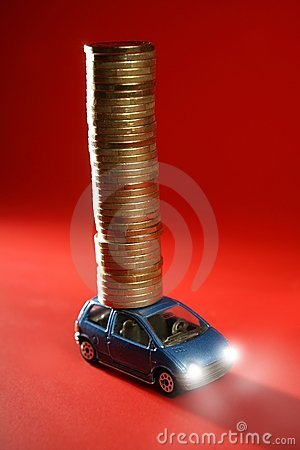 Toy car with huge column of golden coins over red