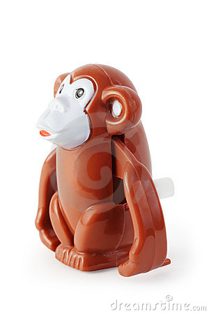 Toy clockwork brown waggish monkey