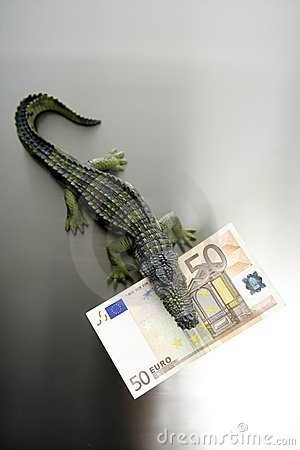Toy cocodrile, aligator, with fifty euro banknote