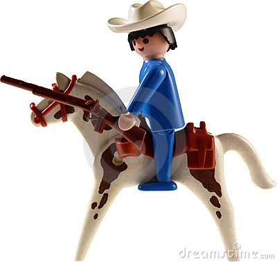 Toy cowboy on horse isolated