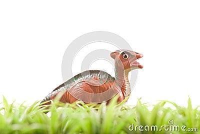 Toy Dinosaur in Grass