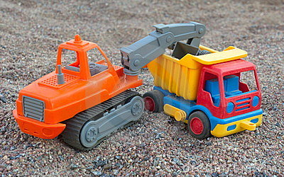 Toy dump truck and shovel