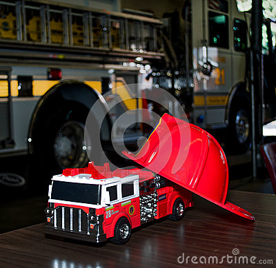 Toy fire truck and real fire truck Editorial Image
