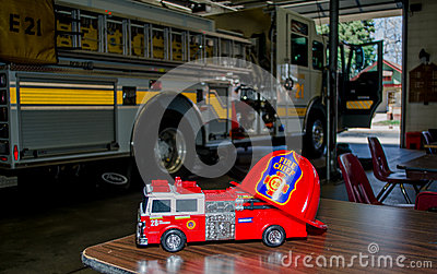 Toy fire truck and real fire truck Editorial Stock Photo