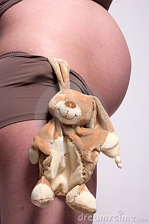 A Toy Hangin By A Pregnant Belly Stock Photography - Image: 5600032