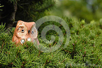 Toy owl in a tree