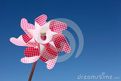 Toy pinwheel against blue sky
