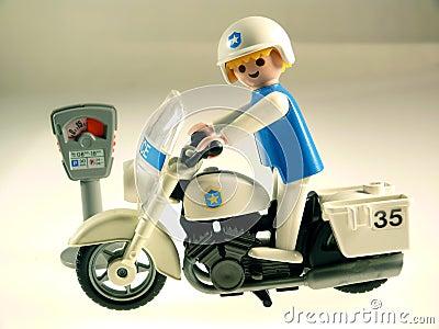 Toy policeman on bike