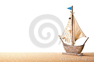 Toy sailboat on sand