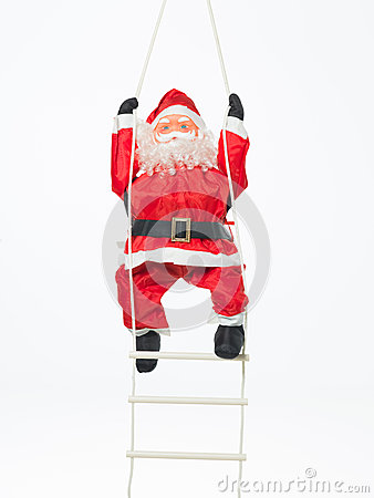 Toy santa climbing a ladder