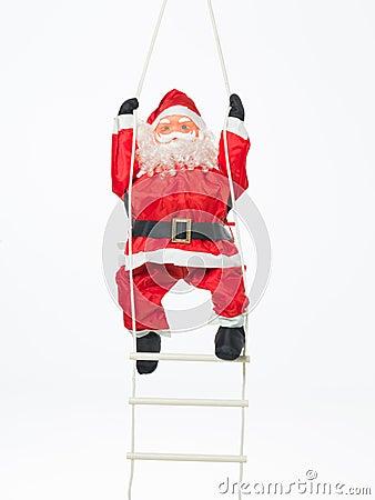 Toy santa climbing a ladder