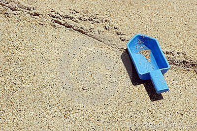 Toy Shovel Left Behind On A Beach
