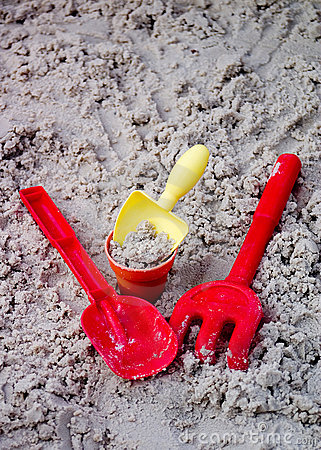 Toy Shovels, Bucket, and Rake in Sand