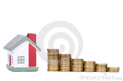 Toy small house and coins