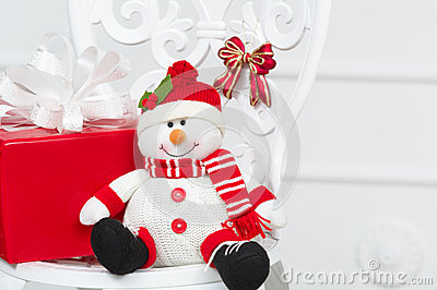 Toy snowman with red box