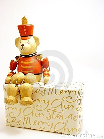 Free Toy Soldier Bear Perched On Christmas Gift Stock Photo - 366410