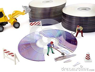 Toy workers repairing computer
