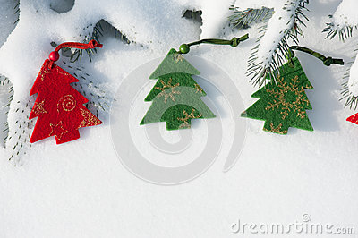 Toys on the christmas tree at snow