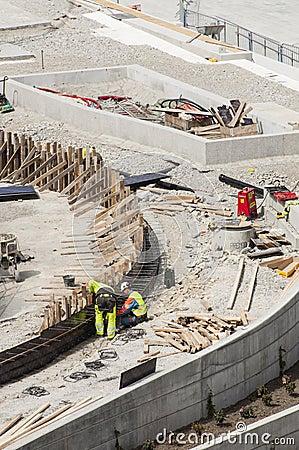 Trabajadores de construcción Foto editorial