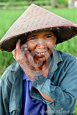 Trabalhador da almofada de arroz Fotografia Editorial