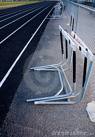 Track & Field Hurdles against fence