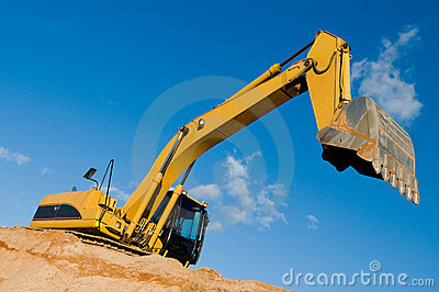 Track-type loader excavator at sand