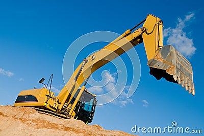 Track-type loader excavator at sand