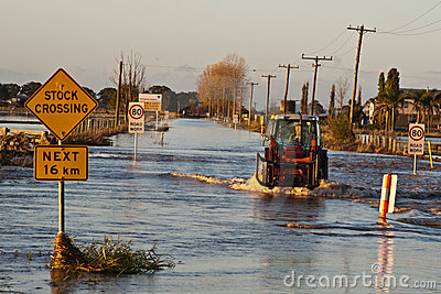 Tractor Crossing Flooded Road Editorial Image