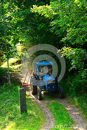 Tractor driving past the road Editorial Stock Photo