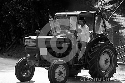 Tractor driving past the road Editorial Image