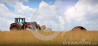 Tractor on farm landscape
