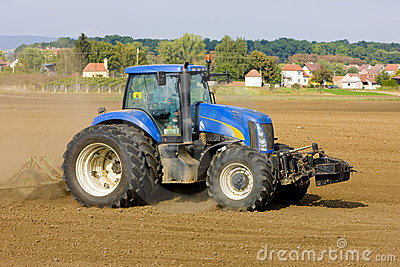 Tractor On Field Stock Photo - Image: 12959910