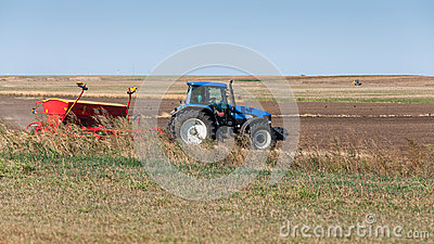 Tractor on field seeding