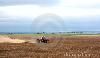 A tractor handles the ground