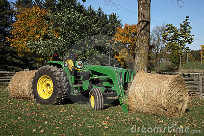 Tractor and Hay Bales Editorial Photo