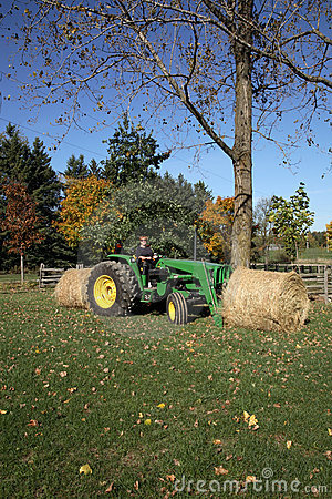 Tractor and Hay Bales Editorial Stock Image