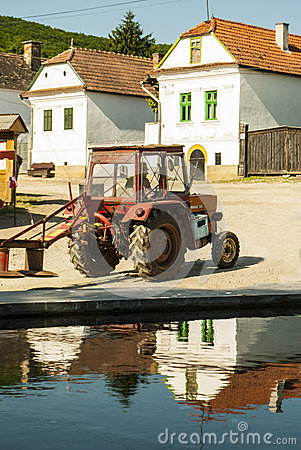 Free Tractor In The Village Royalty Free Stock Image - 55148396