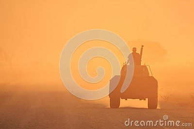 A Tractor and its Driver - Golden Dust Sunset Background, from the wilds of Africa