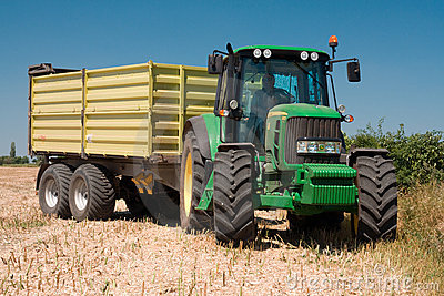 Tractor John Deere on harvested field Editorial Photography