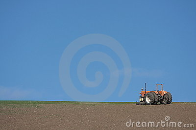 Tractor on ploughed field